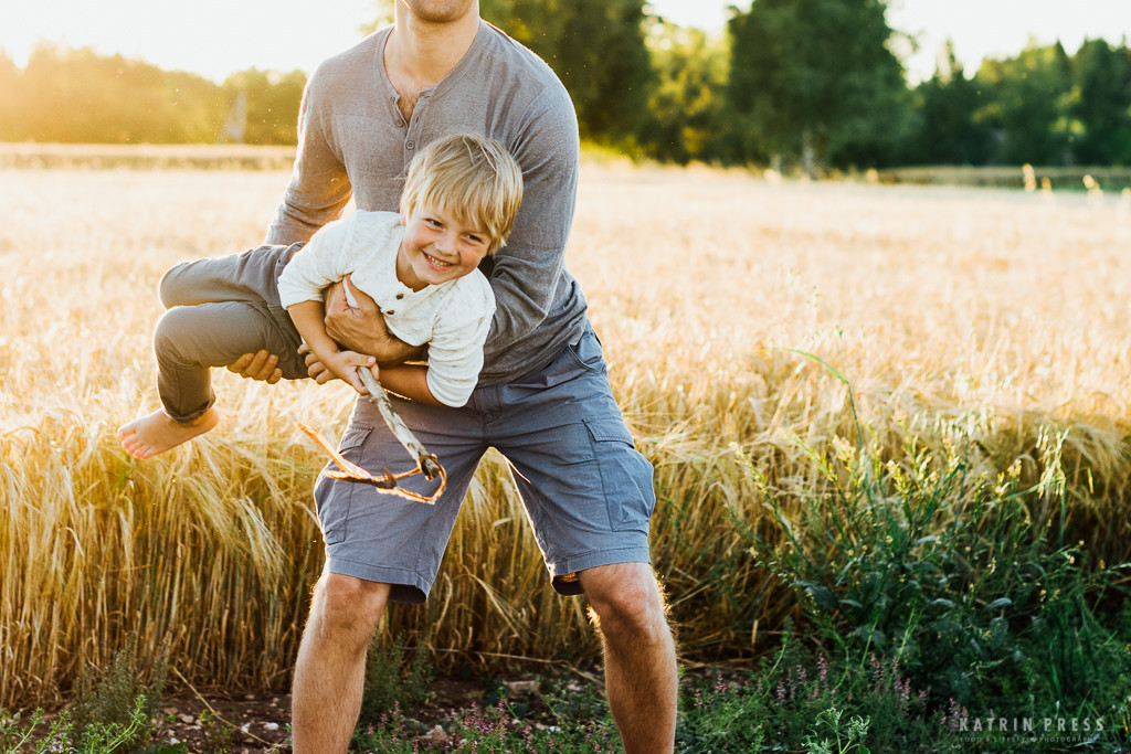 "ALT=""boy, dad, fun, golden hour, field, sunset, family time"""